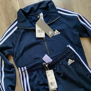 Absolutely NEW  tracksuit by Adidas in size XS